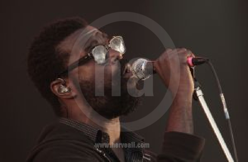 Tunde Adebimpe performing